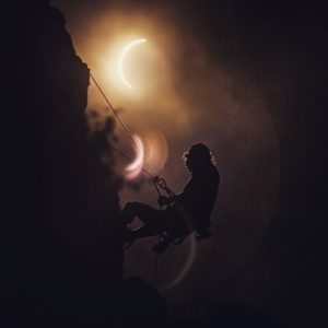 Climber during eclipse