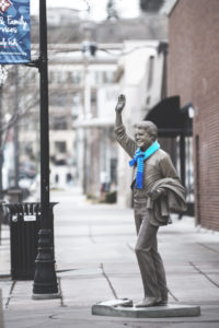 President statue downtown scarf